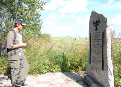 Next to a memorial in Yanovichi. Photo taken in 2009.