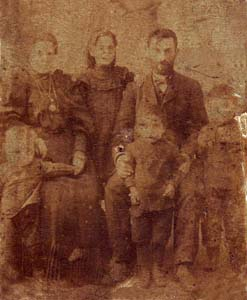 Grandfather Mendel Menakhin, his wife and senior sons.