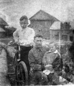 Lev Manevich, his younger brother and father.